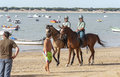 Sanlucar beach horse races de barrameda racing th august cadiz province andalusia spain the mounted section of the guarda civil on Stock Photos