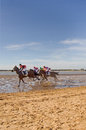 Sanlucar races de barrameda cadiz spain august unidentified riders race on the famous race of the beach of de barrameda on Stock Photography