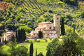 Sant antimo montalcino church and olive tree orcia tuscany it castelnuovo abate secular val d italy europe Royalty Free Stock Images