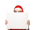 Santa advertisement woman in new year or christmas hat hiding behind the isolated on white background Stock Photos