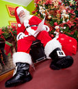 Santa asleep with a wish list Royalty Free Stock Photography