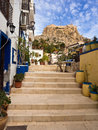 Santa barbara castle in alicante spain view of from a street the old town of Royalty Free Stock Image
