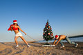 Santa at the beach Royalty Free Stock Photo