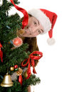 Santa behind a christmas tree Royalty Free Stock Images