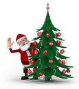 Santa behind Christmas Tree Stock Photos