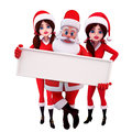 Santa with a big sign and two girls with him Stock Photos