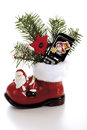 Santa boot with mobile-phone Royalty Free Stock Photo