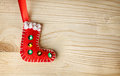 Santa boot toy christmas from felt on wooden background Royalty Free Stock Photography