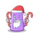 Santa with candy purple teapot character cartoon Royalty Free Stock Photo