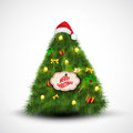 Santa cap on Christmas Tree. Royalty Free Stock Photo