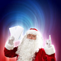 Santa with christmas letter holding letters and looking at camera Royalty Free Stock Photos