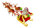 Santa christmas sleigh cartoon in his waving back at the viewer Royalty Free Stock Photography