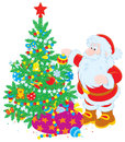 Santa and Christmas tree Royalty Free Stock Photography