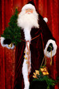 Santa with a Christmas Tree and Christmas Gifts Royalty Free Stock Photography