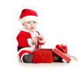 Santa Claus baby with gift box Royalty Free Stock Image
