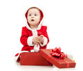 Santa Claus baby girl with gift box on white Royalty Free Stock Photo
