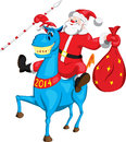 Santa claus with a bag on blue horse Stock Photo