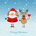 Santa claus with a bag of deer and the christmas card Royalty Free Stock Photography