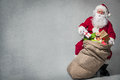 Santa claus with a bag of presents full Royalty Free Stock Image