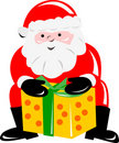 Santa Claus bearing a gift Royalty Free Stock Image