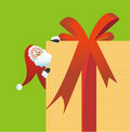 Santa Claus behind gift box Stock Photography
