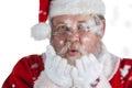 Santa claus blowing fake snow Royalty Free Stock Photo