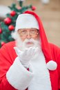 Santa claus blowing kiss portrait of outdoors Stock Photo