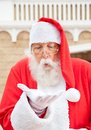 Santa claus blowing in palm outdoors Stock Photography