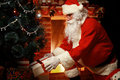 Santa Claus brought gifts for Christmas and having a rest Royalty Free Stock Photo