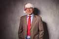 Santa claus business man standing with hands in pockets relaxed and smiles studio Stock Photography