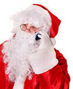 Santa Claus  calling by phone. Royalty Free Stock Image