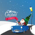 Santa Claus in car for Christmas celebration.