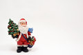 Santa claus carrying christmas gifts on white background Royalty Free Stock Images