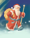 Santa claus carrying gifts bag with in the winter night Royalty Free Stock Images