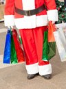 Santa claus carrying shopping bags Stock Foto
