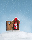 Santa claus caught in the act while sitting on toilet a snowy day at a snow hill Royalty Free Stock Image