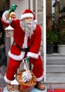 Santa Claus in a characteristic street of the old town of Crema in the province of Cremona in Lombardy (Italy) Royalty Free Stock Photo