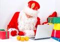 Santa Claus checking wish list. Royalty Free Stock Photo