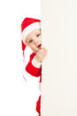 Santa claus child looking from behind placard Royalty Free Stock Image