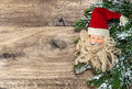 Santa claus christmas decoration with pine tree branch over rustic wooden background Stock Photos