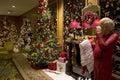 Santa Claus Christmas trees lights luxury hotel lobby Royalty Free Stock Photo