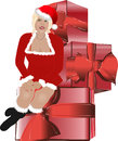 Santa claus christmas women sit on huge gift box woman look happy and giftbox Royalty Free Stock Photos