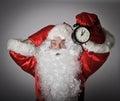 Santa Claus and a clock Royalty Free Stock Photo