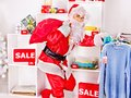 Santa claus in clothing store christmas sale Stock Image