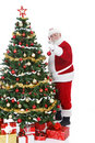Santa Claus decorating  Christmas tree Royalty Free Stock Photo
