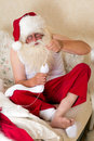Santa claus doing mending socks funny his own Stock Image