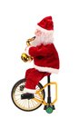 Santa claus doll on a bike isolated white background Stock Photo