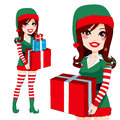 Santa claus elf helper beautiful woman carrying christmas presents Stock Photos