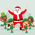 Santa claus and elves with little helper dancing around preparing gifts to deliver on christmas day Royalty Free Stock Photo