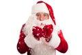 Santa Claus in eyeglasses blowing snow Royalty Free Stock Photo